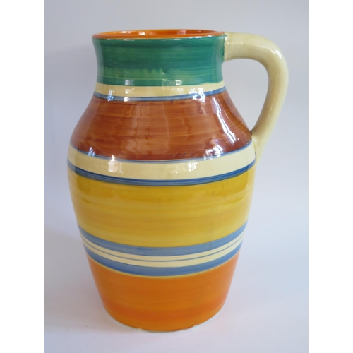258 - A Clarice Cliff Bizarre Lotus Shape Jug decorated with bands of orange, blue, yellow, brown and gree...