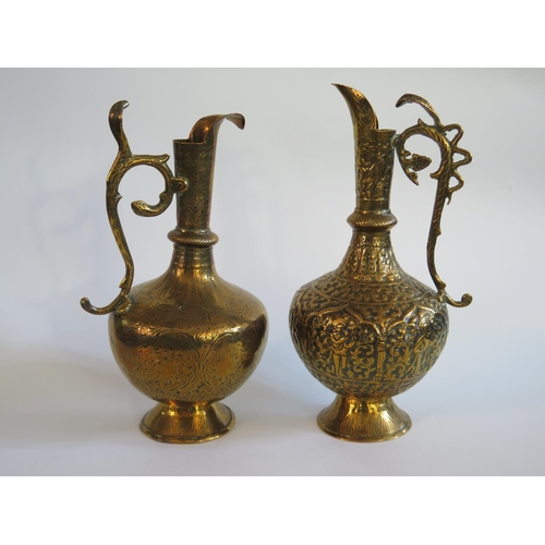 259 - Two Indian Brass Ewers...