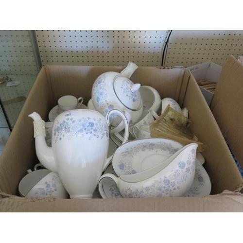 328 - A Wedgwood Belle Fleur Dinner, Tea and Coffee Set...