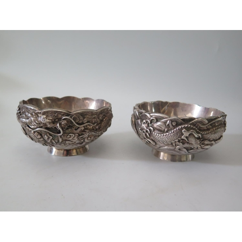 32A - A Pair of Chinese Silver Bowls with double walled construction and decorated with dragons, mark to b...