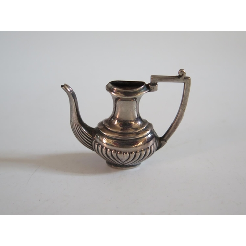 40 - A Birmingham Silver Miniature Pot...