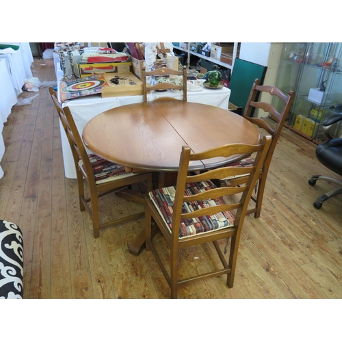 475 - An Ercol Dining Table and Four Chairs...