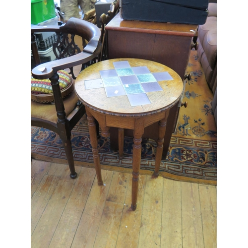 484 - An Arts & Crafts Oak Tile Top Occasional Table...