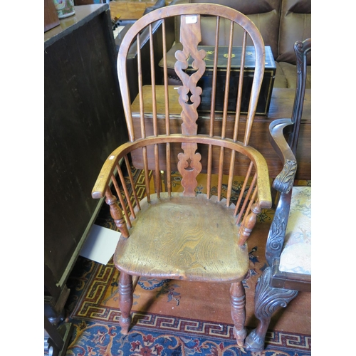 488 - A Nineteenth Century Elm Seated Windsor Chair...
