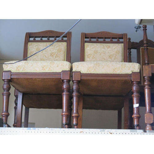 502 - A Set of Four Edwardian Mahogany Side Chairs with overstuffed seats and padded backs...