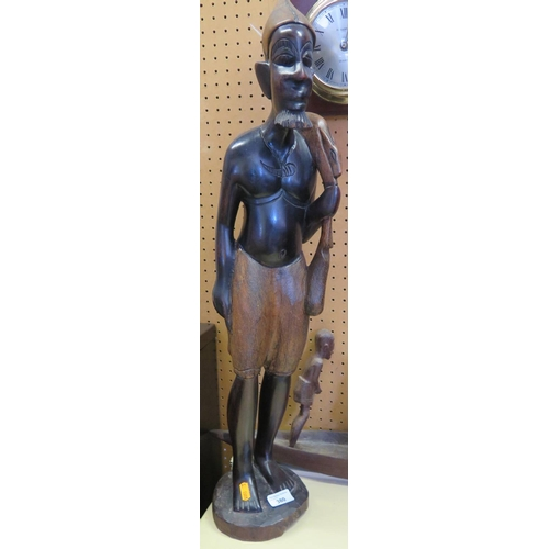 533 - An African Carved Wooden Standing Figure...