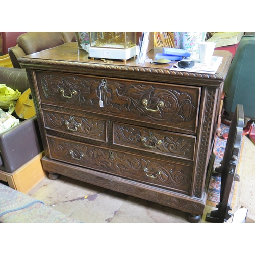 539 - An Eighteenth Century Carved Oak Secretaire Chest...