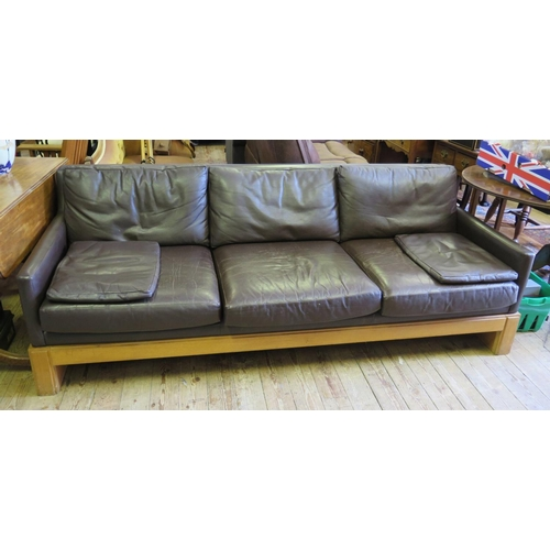 542 - A Miles Carter Three Seater Brown Leather Sofa. Miles Carter designed furniture for the British Libr...