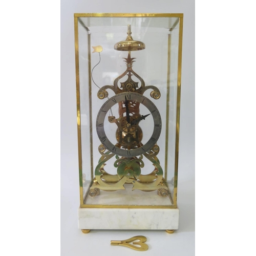 543 - A Brass Skeleton Clock on marble base with a single fusee sticking movement and carrying case, 50cm...