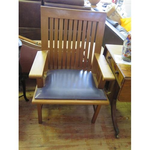 550 - A Miles Carter Oak Slat Back Open Armchair...