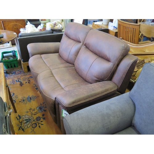 559 - A Brand New Two Seater Leatherette Sofa...