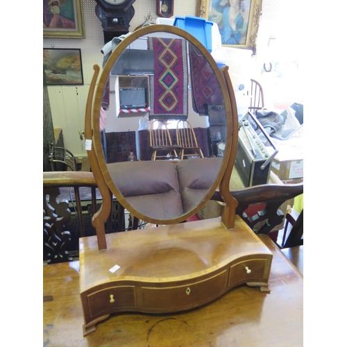 562 - A Nineteenth Century Mahogany and Boxwood Strung Swivel Toilet Mirror...