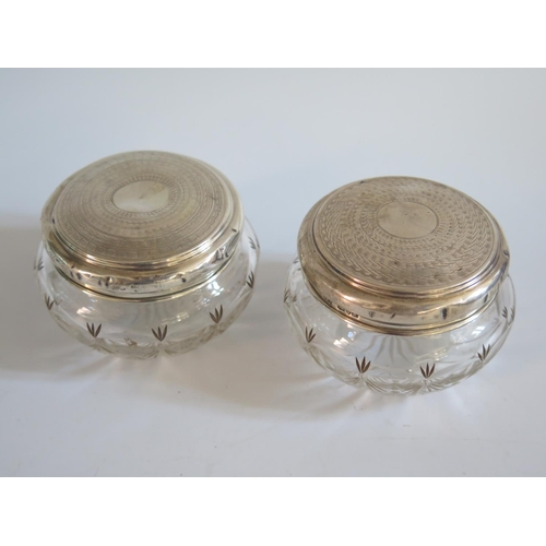 58 - A Pair of Chester Silver Top Cut Glass dressing Table Pots...