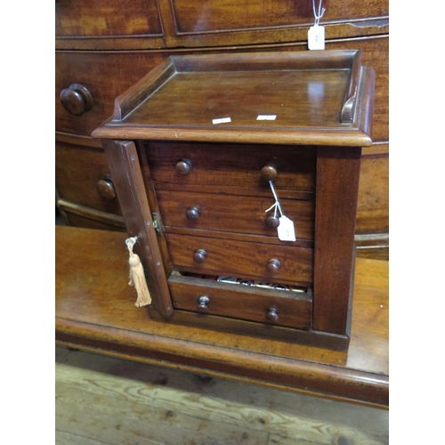 614 - A Small Victorian Mahogany Table Top Wellington Chest...