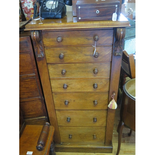 615 - A Victorian Walnut Wellington Chest, with key in office...