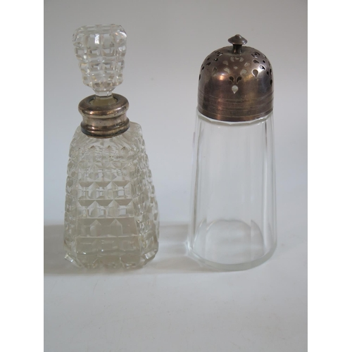 8 - A Birmingham Silver Topped Slice Cut Glass Sugar Castor and silver collar perfume bottle...