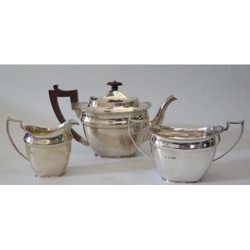 96 - An Edward VIII Silver Three Part Tea Set, Birmingham 1930 and 31, MH&CoLd., 1091g gross...