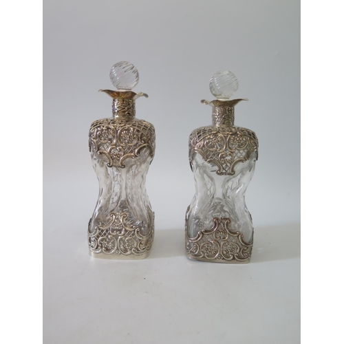 9b - A Pair of Victorian Decanters of Waisted Form with silver mounts, London 1896, W.C...