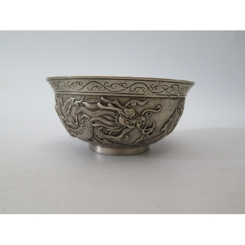 9c - A Chinese Metal Bowl decorated with dragons, mark to base, 545g...