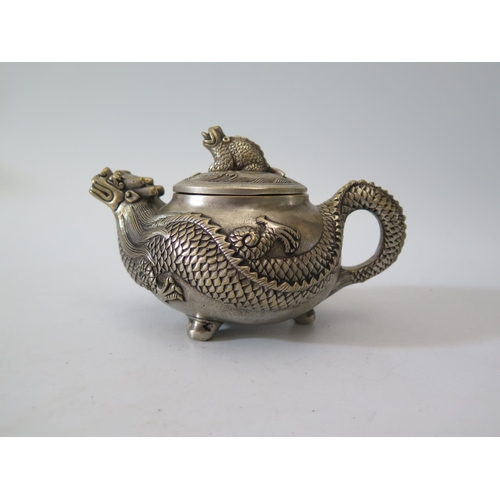 9D - A Chinese Silver Plated Teapot with dragon spout and body extending to the pot, mark to base, 546g...