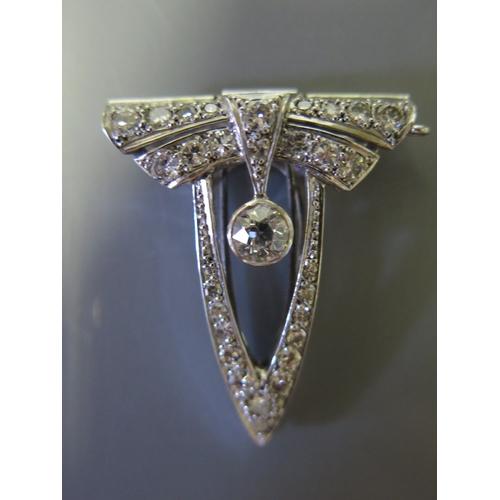 136A - An Art Deco Platinum Set Diamond Clip, 6.9g, central diamond c. .6ct...