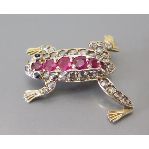 182 - A Ruby, Diamond and Sapphire Frog Brooch in a high carat precious yellow metal setting, 27mm long, 3...