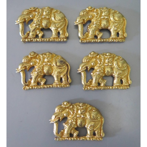 185 - A Set of Five Asian Precious Yellow Metal Elephant Dress Accoutrements, c. 34mm long, 15.3g...
