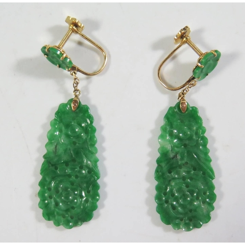 199 - A Pair of Chinese Carved and Pierced Jadeite Screw Back Pendant Earrings, c. 50mm drop. Sold with tw...