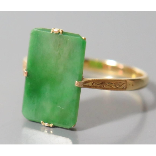 200 - A Chinese 14K Yellow Gold and Jadeite Ring, size T.5, 2.53g. Sold with Gem & Pearl Laboratory Report...