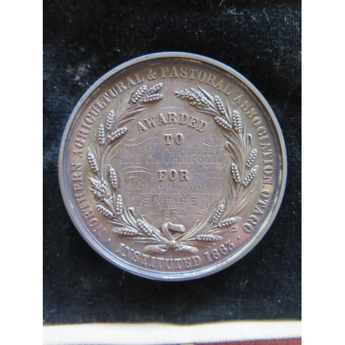 294 - A Northern Agricultural & Pastoral Association Silver Medallion awarded to Hon R Campbell for 2nd Be...