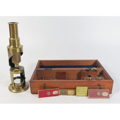 302c - A Small Nineteenth Century Brass Microscope in fitted case and with slides, 17.5cm...