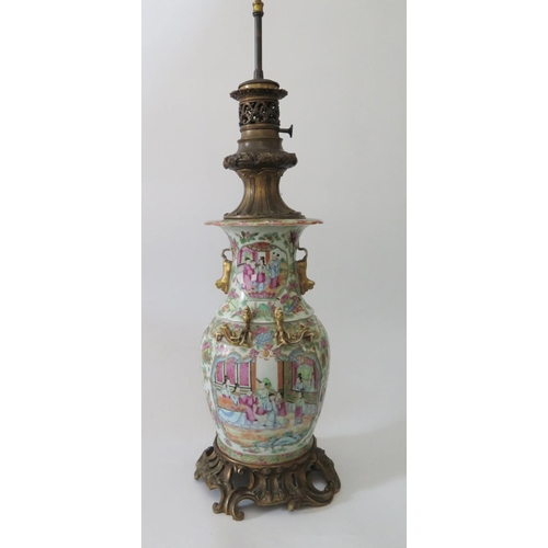 371 - A Nineteenth Century Cantonese Porcelain Famille Rose Vase with rococo ormoulu mounts, drilled to ba...