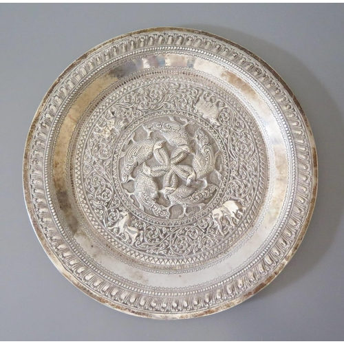 7 - An Indian Silver Plate with stylised foliate decoration and central reserve of geese with entwined n...