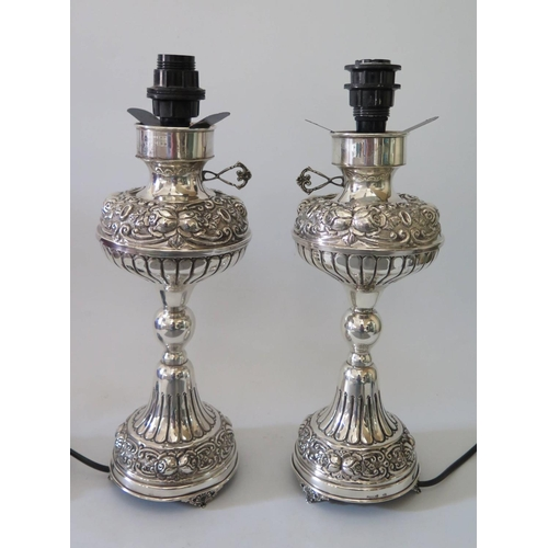 8 - A Pair of Continental Sterling Silver Lamp Bases with foliate scroll and rose decoration comma 29cm ...