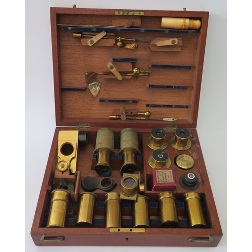 302e - A Cased Binocular Microscope by J. Swift of 15 Kingsland Road No. 1570 with fitted case of lenses...