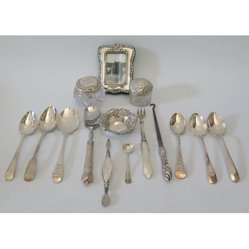 14 - A small silver photograph frame, two silver dressing table pots cutlery etc...