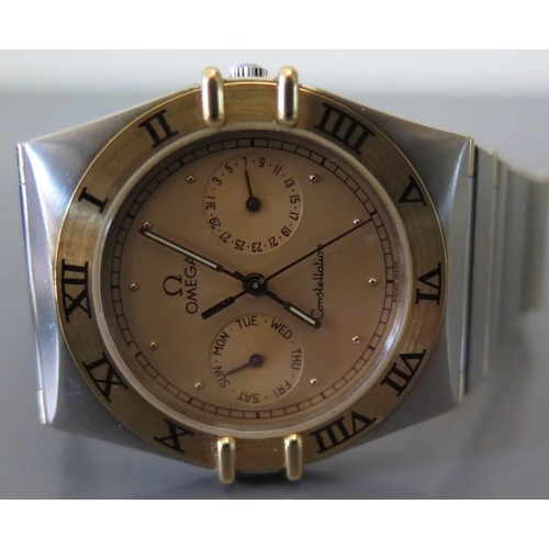 153 - A 1991 Omega Constellation bi metal Day date wristwatch with box and papers...