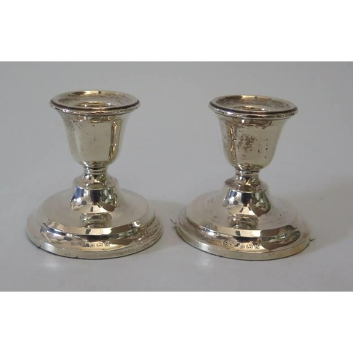 16 - A pair of modern loaded silver candlesticks...