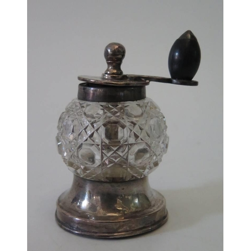 22 - A Victorian silver and cut glass pepper grinder, London 1898...