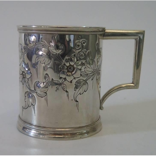 24 - An American white metal christening cup by R and W Wilson...