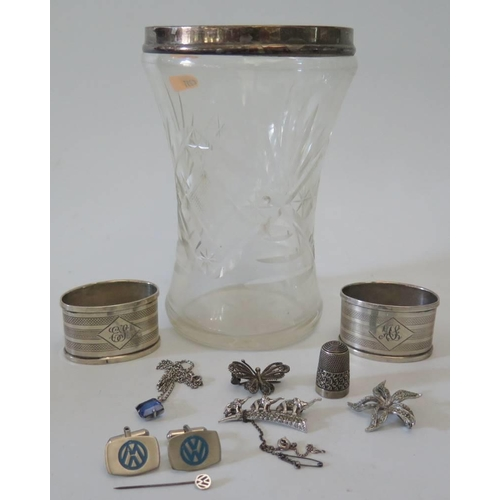 25 - A silver coloured cut glass vase, pair of napkin Rings, thimble etc...