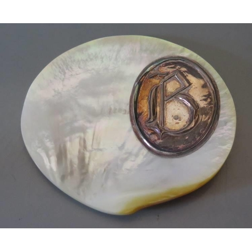 26 - A silver mounted mother of pearl pin dish...