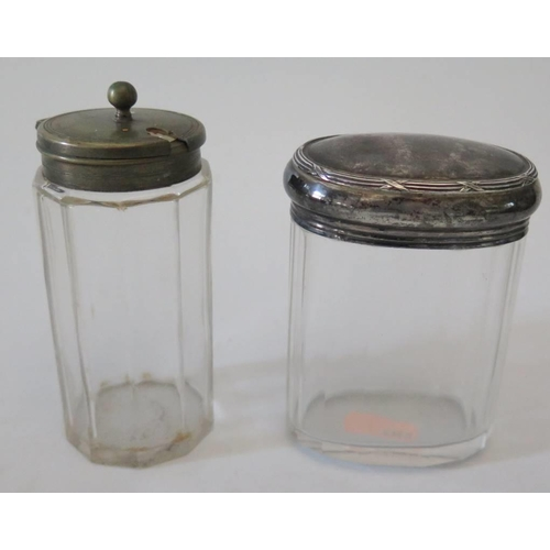 32 - A silver top slice cut glass dressing table pot and one other...