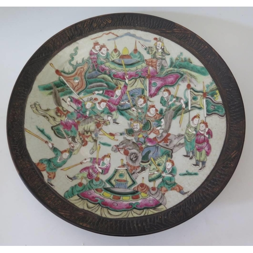 359 - A 19th Century Chinese porcelain charger decorated with battle scene, 37 cm...