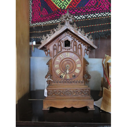 564 - A black forest cuckoo clock with twin fusee movement, unmarked AF. 46cm Height...