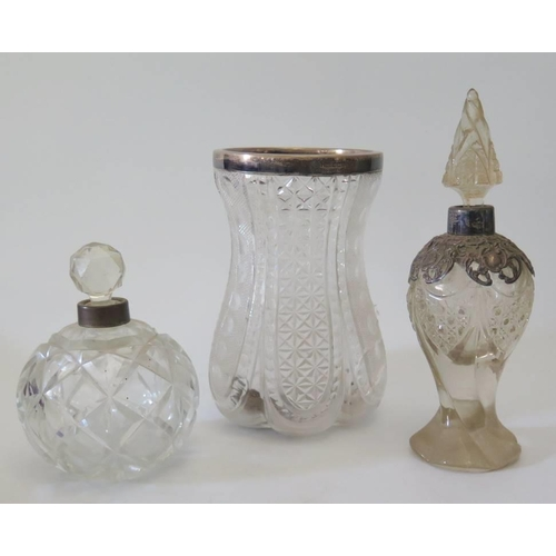 7 - A silver collared cut crystal vase and two others...