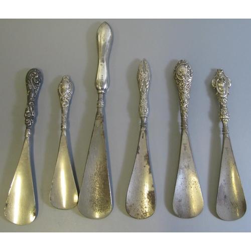 6 - Six Silver Handled Shoe Horns...