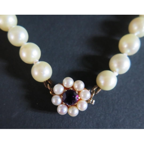 1 - A Cultured Pearl Necklace with amethyst set 9ct yellow gold clasp, 67cm...