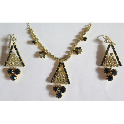 11 - A Costume Necklace and Earring Set...