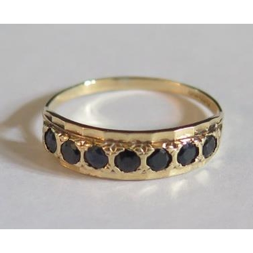 24 - A 9ct Yellow Gold Seven Stone Sapphire Ring, size T, 1.8g...